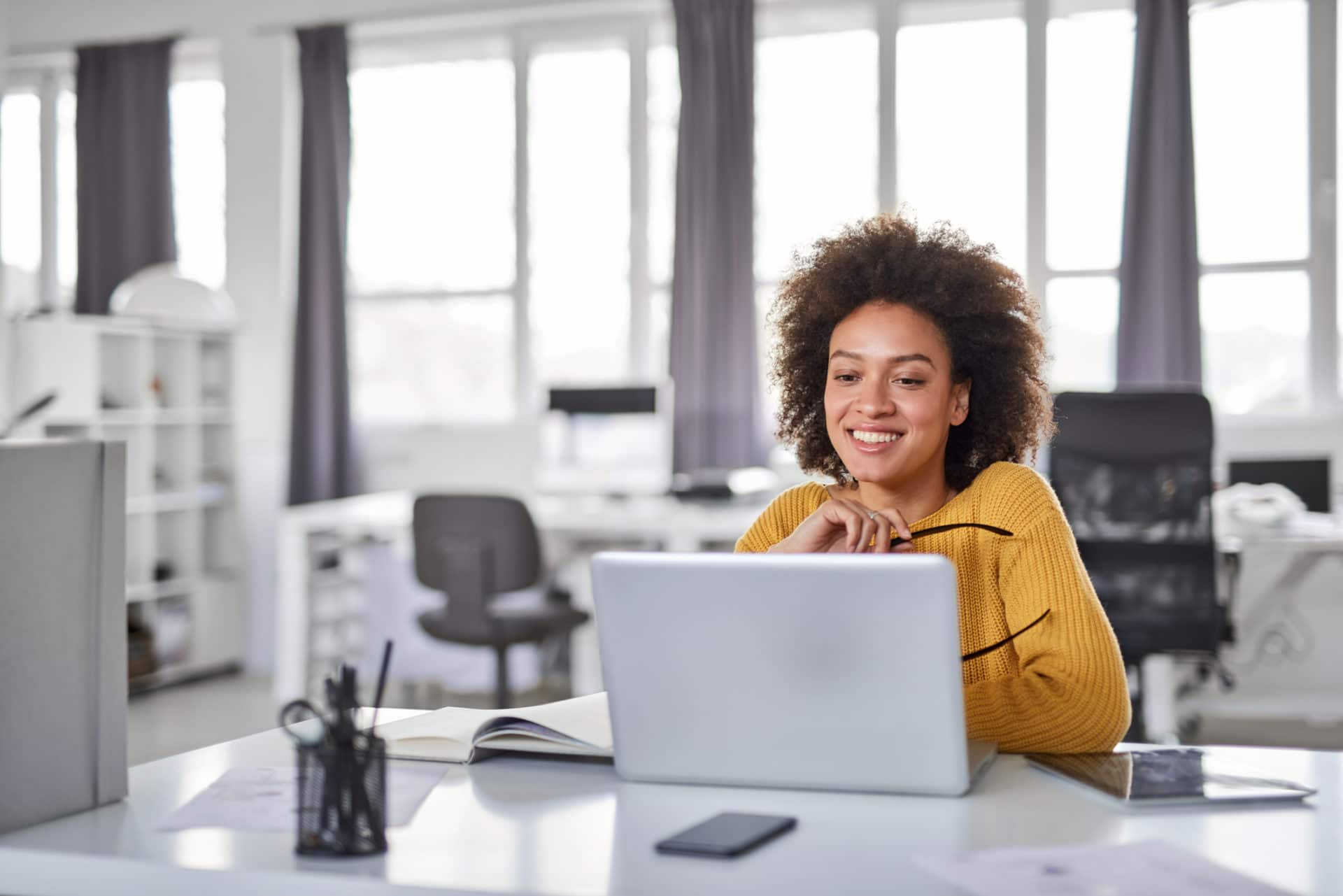 Businesswoman Increasing Productivity With Microsoft Teams